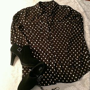 Black blouse with gold and white dots.